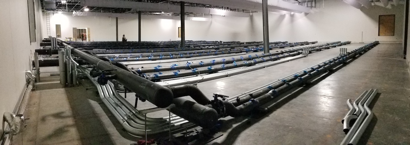 Underfloor piping is laid inside the data centre for the DUG Cool system feeding the first four rows our tanks