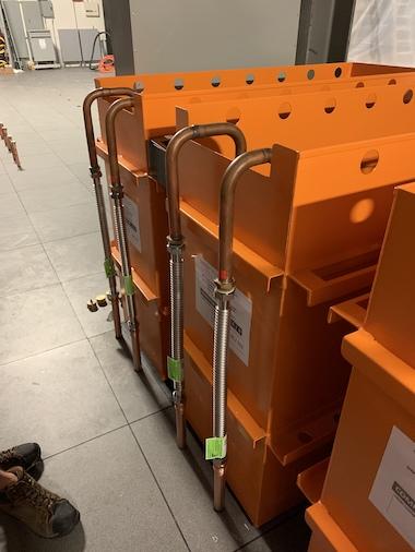 Orange DUG cooling tanks being installed in Houston